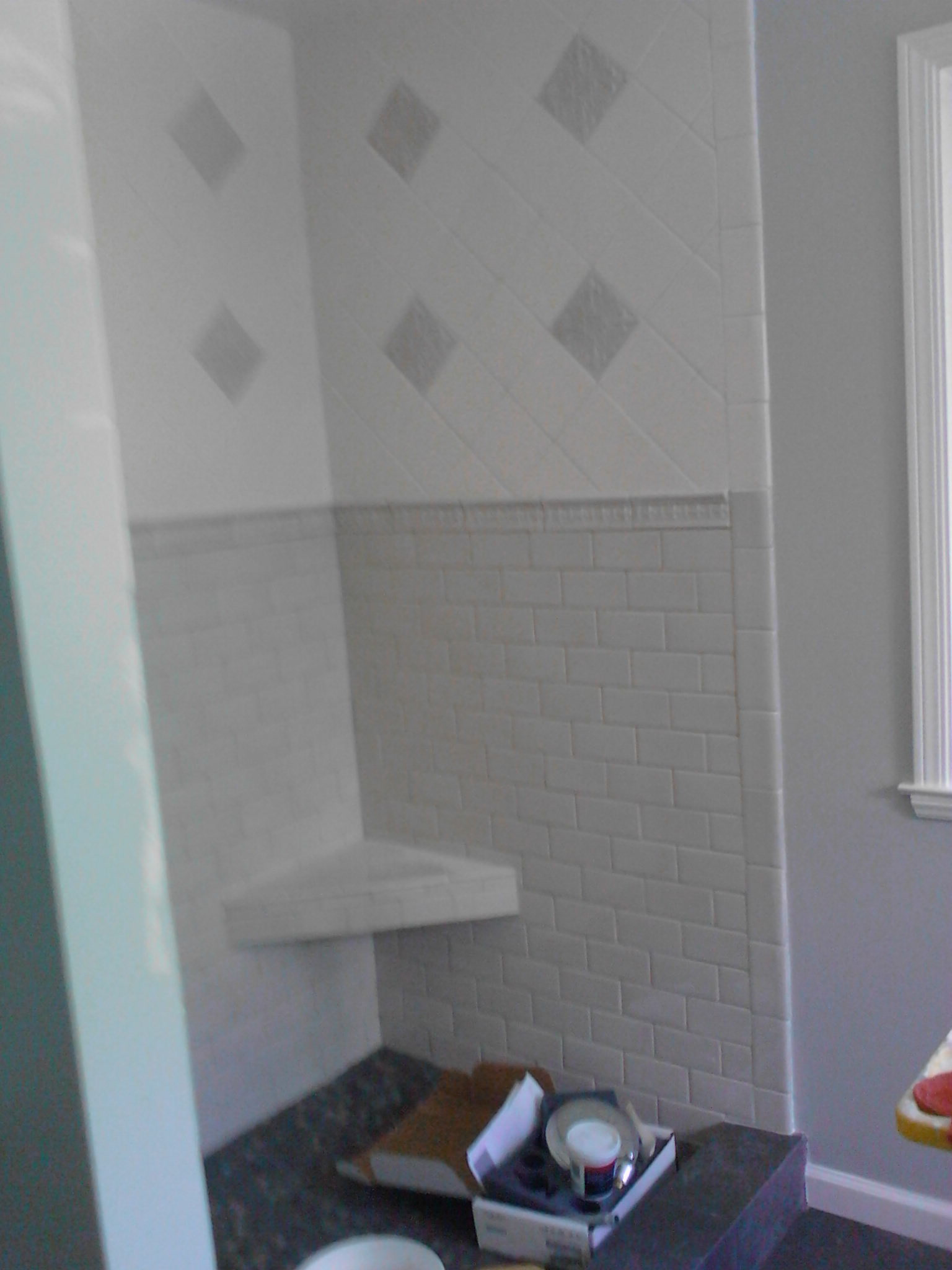 Tile bench in shower, after