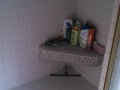 Tile bench in shower, before